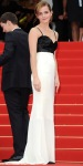 Emma Watson in a black & white colorblocked Chanel Couture column gown with a Repossi ear cuff.