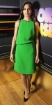 Freida Pinto in a bright green asymmetric shift dress with patent leather stilettos.
