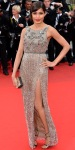 Freida Pinto in a sparkling Sanchita column gown with strappy sandals & a pearl Daniel Swarovski ox clutch.