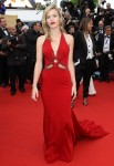 Georgia May Jagger in a red deep-v Roberto Cavalli gown.