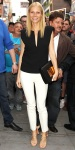 Gwyneth Paltrow in a black deep-v Barbara Bui top with white pants & metallic strappy sandals.