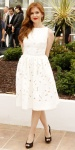 Isla Fisher in a white a-line Dolce & Gabbana dress with black peep toe Roger Vivier shoes.
