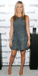 Jennifer Aniston in a drop-waist gray suede shift dress with nude ankle-strap sandals.