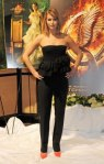 Jennifer Lawrence in a black strapless structured top by Dior with black pants & orange pointy toe pumps.