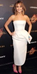Jennifer Lawrence in an asymmetric Dior column gown with hot pink pointy toe pumps.