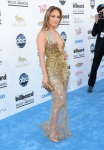 Jennifer Lopez in a deep-v gold  sequin embellished Zuhair Murad gown with pointy toe pumps.