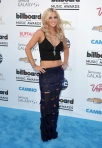 Jenny McCarthy in a black tank & shredded sequined maxi skirt.