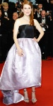 Julianne Moore in a purple lame & black bustier evening dres sby Dior Haute Couture with Chopard jewelry.