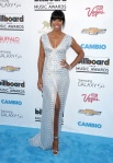 Kelly Rowland in a silve embellished deep-v gown by Rami Al Ali.