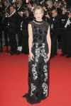 Kirsten Dunst in a black embellished cap sleeve Michael van der Ham gown.