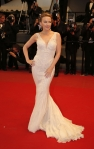 Kylie Minogue in a white deep-v Roberto Cavalli gown.