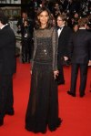 Liya Kebede in a black embellished long-sleeved Roberto Cavalli gown.