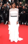 Liya Kebede in a white sheer long-sleeved Alberta Ferretti belted gown.