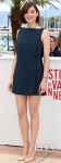 Marion Cotillard in a dark green mini dress by Antonio Berardi with nude pointy toe pumps.