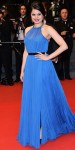 Melonie Diaz in a bright blue Emilio Pucci design with a black belt.