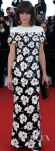 Milla Jovovich in a black white & red floral print embellished Chanel column gown.
