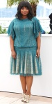 Octavia Spencer in a turquoise pleated Chantilly lace dress by Tadashi Shoji.
