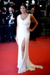 Rosario Dawson in a white sparkling slitted Elie Saab gown.