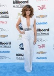 Stana Katic in a white deep-v silver belted jumpsuit by Nicholas Oakwell.