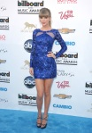 Taylor Swift in a blue sequin Zuhair Murad mini dress with silver strappy heels.