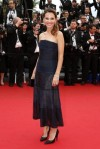 Virginie Ledoyen in a navy strapless tea-length dress.