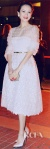 Zhang Ziyi in a dotted white belted Valentino Couture dress with matching white pointy toe pumps.