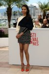 Zoe Salanda in a black & white highwaist polka dot skirt & top by Emanuel Ungaro with ankle strap orange heels.