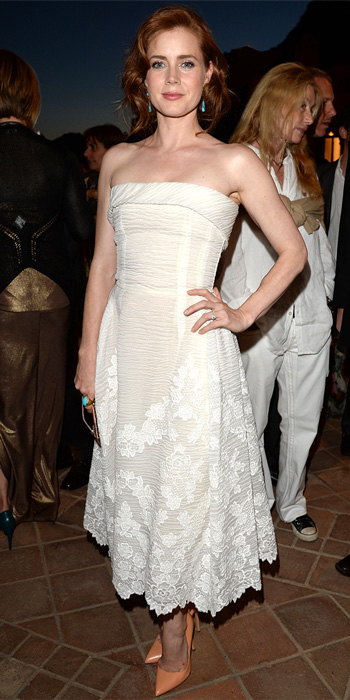 Amy Adams in a white lace strapless Dolce Gabbana dress with