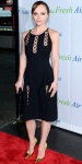 Christina Ricci in a peek-a-boo Thakoon black dress with gold pointy toe stilettos.