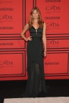 Constance Jablonski in a black ruched sheer J. Mendel dress