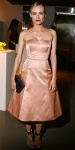 Diane Kruger in a blush strapless Jason Wu dress with studded ankle strap heels & a boxed clutch.