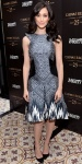 Emmy Rossum in a pleated mixed print dress by Bibhu Mohapatra with black pointy toe heels.