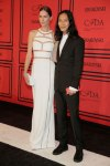 Erin Wasson in a white cut-out Alexander Wang dress with Alexander Wang