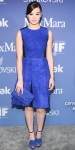 Hailee Steinfeld in a sleeveless blue Sportmax dress with an envelope clutch & cobalt Jimmy Choo heels.