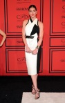 Hilary Rhoda in a black & white Helmut Lang dress & ankle strap sandals.