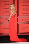 Ireland Baldwin in a red David Meister gown.