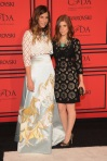 Irene Neuwirth & Kate Mara in a black lasercut Dolce & Gabbana shift dress