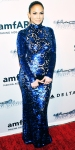 Jennifer Lopez in a blue-sequined long-sleeve Tom Ford gown.