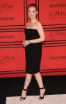 Jessica Chastain in a black strapless Givenchy dress with black & metallic ankle strap heels.