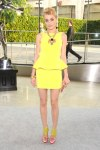 Jessica Stam in a yellow peplum Rebecca Minkoff dress