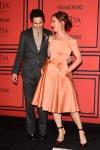 Juliette Lewis in a cream Zac Posen dress with burgundy ankle strap shoes & Zac Posen