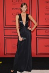 Karlie Kloss in a black deep-v gown by Cushnie et Ochs