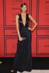Karlie Kloss in a black deep-v gown by Cushnie et Ochs