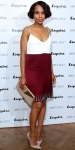 Kerry Washington in a white & maroon colorblocked dress with embellished straps & metallic cap toe pumps.