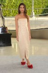 Lily Aldridge in a cream strapless dress by The Row & red peep toe shoes.