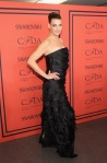 Linda Evangelista in a black ruffle tiered strapless Oscar de la Renta gown