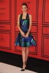 Miranda Kerr in a multicolor Proenza Schouler dress with ankle strap pumps.