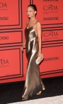 Nicole Richie in a gold Marc Jacobs slipdress with gold pointy toe pumps