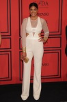 Rachel Roy in a white sheer-sleeve jumpsuit.
