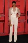 Rachel Roy in a white sheer-sleeve jumpsuit.